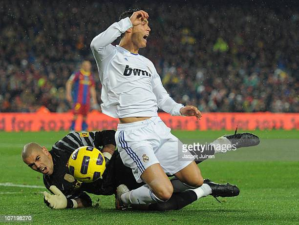 Cristiano Ronaldo of Real Madrid is fouled in the penalty aeria by goalkeeper Victor Valdes of Barcelona during the la liga match between Barcelona...
