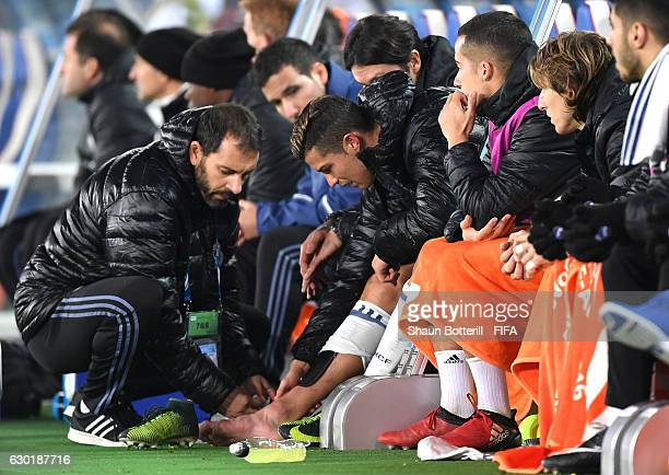 Cristiano Ronaldo of Real Madrid is given treatment from the bench following a knock during the FIFA Club World Cup Final match between Real Madrid...