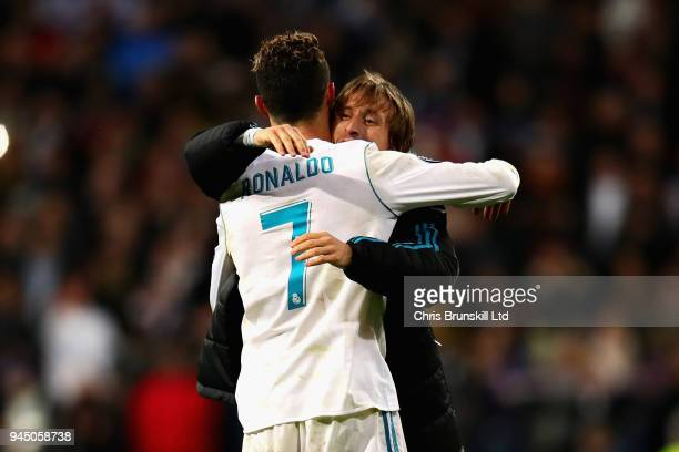Cristiano Ronaldo of Real Madrid is hugged by teammate Luka Modric after the UEFA Champions League Quarter Final second leg match between Real Madrid...
