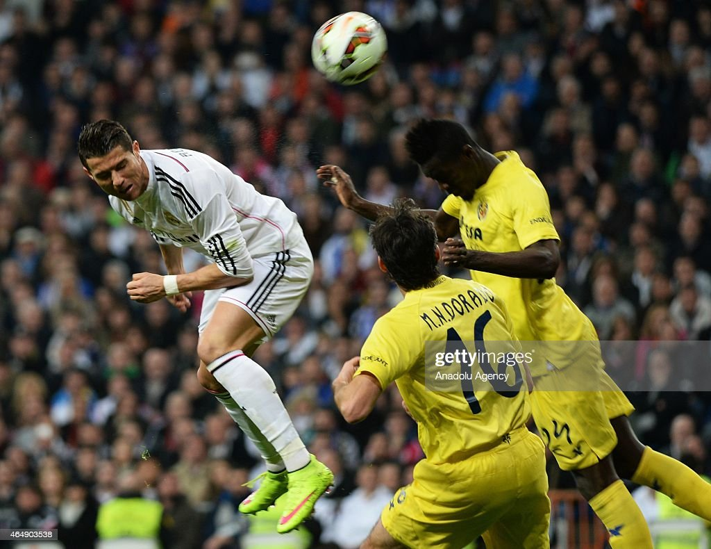 Cristiano Ronaldo (L) of Real Madrid is in action against Eric Bailly (R) of Villarreal during the La Liga match between Real Madrid and Villarreal at Estadio Santiago Bernabeu in Madrid, Spain on March 1, 2015.