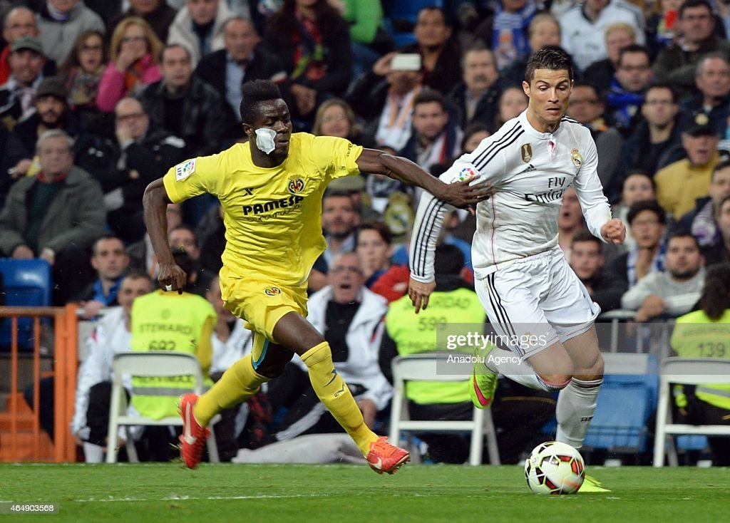 Cristiano Ronaldo (R) of Real Madrid is in action against Eric Bailly (L) of Villarreal during the La Liga match between Real Madrid and Villarreal at Estadio Santiago Bernabeu in Madrid, Spain on March 1, 2015.