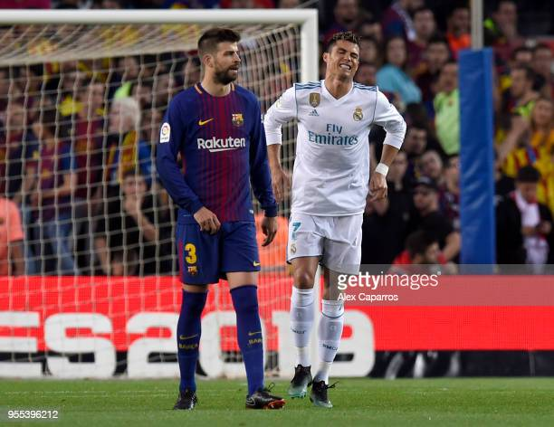 Cristiano Ronaldo of Real Madrid is injured as he scores his sides first goal during the La Liga match between Barcelona and Real Madrid at Camp Nou...