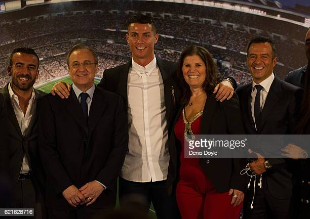 Cristiano Ronaldo of Real Madrid is joined by his mother Maria Dolores dos Santos Aveiro and club President Florentino Perez , and his agent Jorge...