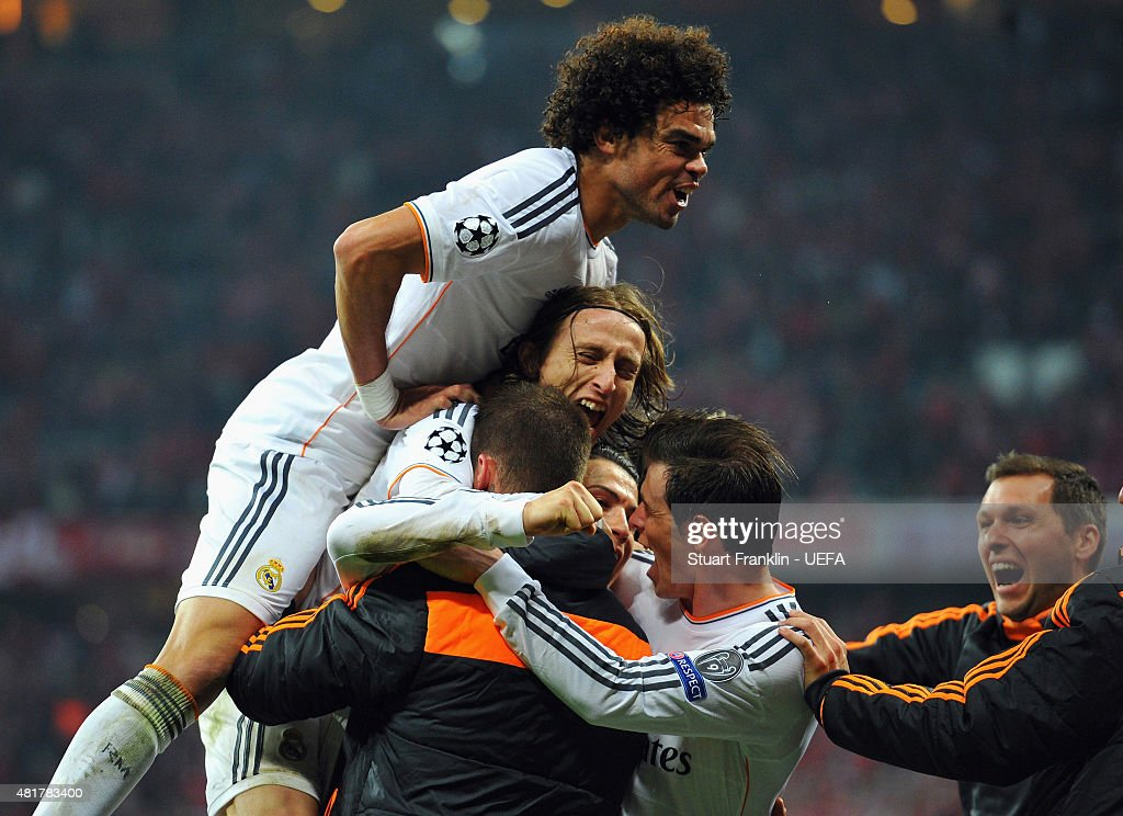 Cristiano Ronaldo of Real Madrid is mobbed by team mates after his second goal during the UEFA Champions League Semi Final second leg match between FC Bayern Muenchen and Real Madrid at Allianz Arena on April 29, 2014 in Munich, Germany.