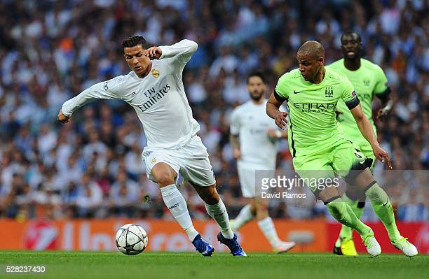 Cristiano Ronaldo of Real Madrid is pursued by Fernando of Manchester City during the UEFA Champions League semi final second leg match between Real...