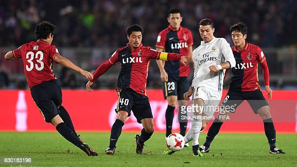 Cristiano Ronaldo of Real Madrid is surrounded by Kashima Antlers players during the FIFA Club World Cup Final match between Real Madrid and Kashima...
