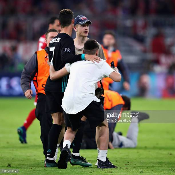 Cristiano Ronaldo of Real Madrid is surrounded by pitch invaders after the UEFA Champions League Semi Final First Leg match between Bayern Muenchen...
