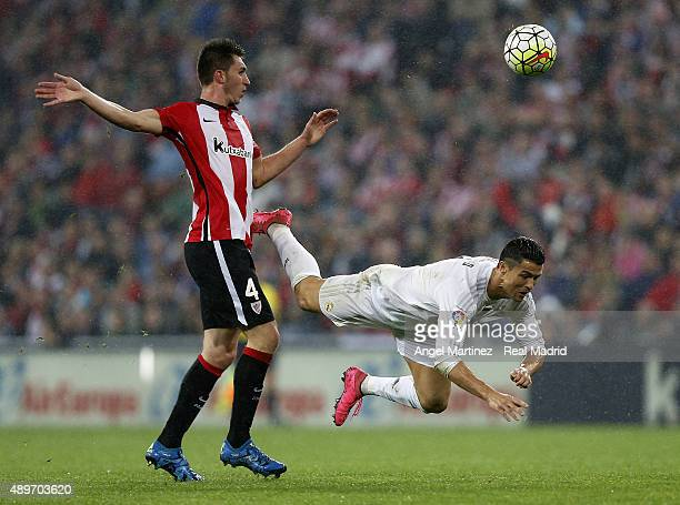 Cristiano Ronaldo of Real Madrid is tackled by Aymeric Laporte of Athletic Club during the La Liga match between Athletic Club and Real Madrid CF at...