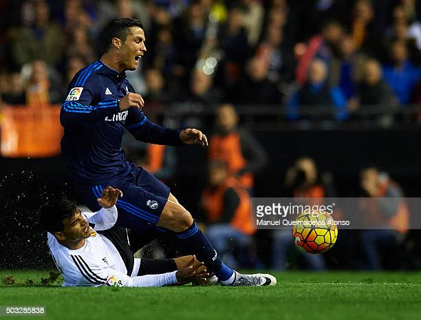 Cristiano Ronaldo of Real Madrid is tackled by Danilo Barbosa of Valencia during the La Liga match between Valencia CF and Real Madrid CF at Estadi...