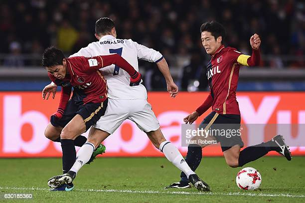 Cristiano Ronaldo of Real Madrid is tackled by Gen shoji of Kashima Antlers during the FIFA Club World Cup final match between Real Madrid and...