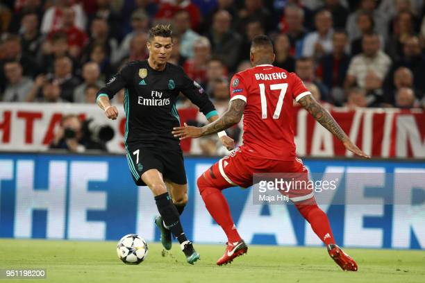 Cristiano Ronaldo of Real Madrid is tackled by Jerome Boateng of Bayern Muenchen during the UEFA Champions League Semi Final First Leg match between...