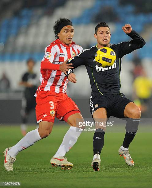 Cristiano Ronaldo of Real Madrid is tackled by Marcelo Silva of UD Almeria during the La Liga match between UD Almeria and Real Madrid at Estadio del...