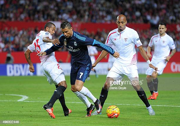 Cristiano Ronaldo of Real Madrid is tackled by Mariano Ferreira of Sevilla FC during the La Liga match between Sevilla FC and Real Madrid CF at...