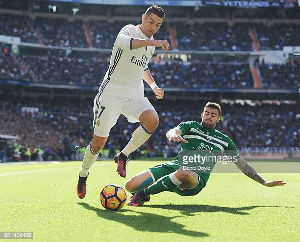 Cristiano Ronaldo of Real Madrid is tackled by Martin Mantovani of CD Leganes controls the ball while being challenged by during the Liga match...