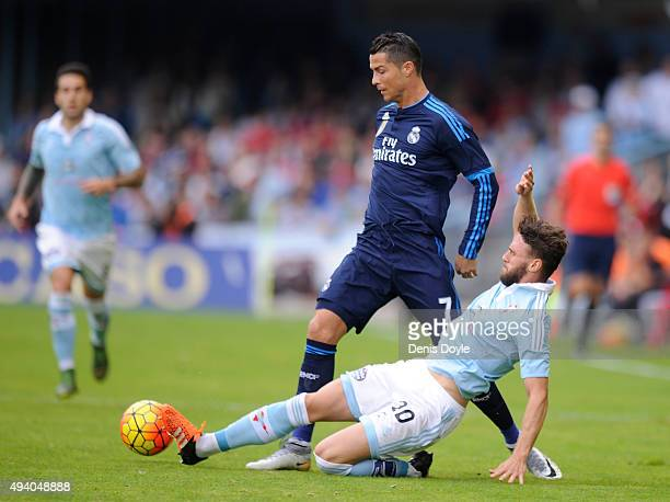 Cristiano Ronaldo of Real Madrid is tackled by Sergi Gomez of Celta Vigo during the La Liga match between Celta Vigo and Real Madrid at Estadio...