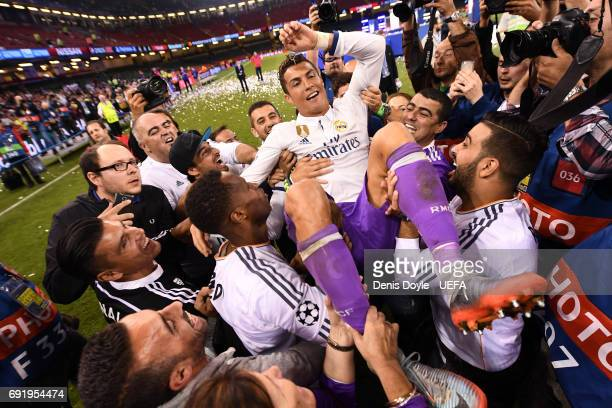 Cristiano Ronaldo of Real Madrid is thrown into the air by his Real Madrid tem mates after the UEFA Champions League Final between Juventus and Real...