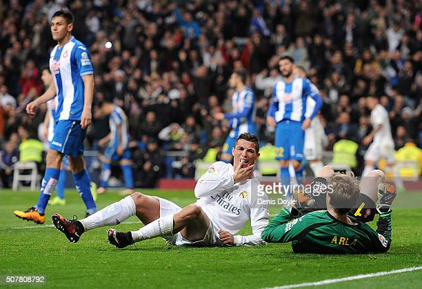 Cristiano Ronaldo of Real Madrid isreacts after bieng kicked in the jaw by accident after beating Giedrius Arlauskis 'Arla' of Real CD Espanyol to...