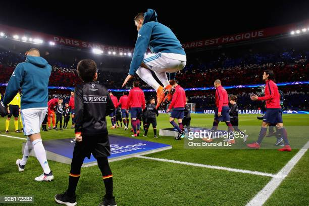 Cristiano Ronaldo of Real Madrid jumps as the teams walk out before the UEFA Champions League Round of 16 Second Leg match between Paris SaintGermain...
