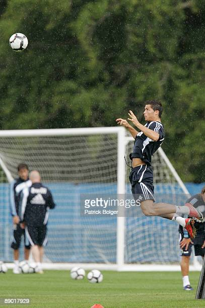 Cristiano Ronaldo of Real Madrid jumps for a header during the Real Madrid preseason training camp at Carton House Hotel on July 14 2009 in Kildare...