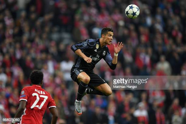 Cristiano Ronaldo of Real Madrid jumps for a header during the UEFA Champions League Quarter Final first leg match between FC Bayern Muenchen and...