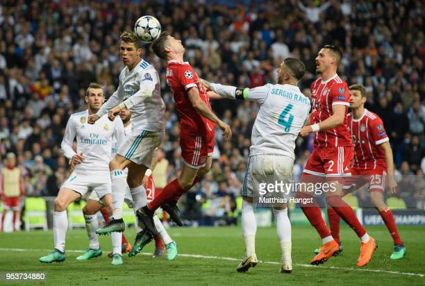 Cristiano Ronaldo of Real Madrid jumps for a header with Robert Lewandowksi of FC Bayern Muenchen during the UEFA Champions League Semi Final Second...