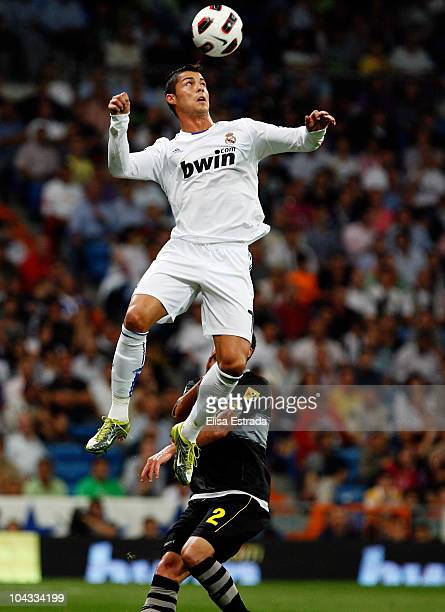 Cristiano Ronaldo of Real Madrid jumps for a high ball during the La Liga match between Real Madrid and Espanyol at Estadio Santiago Bernabeu on...