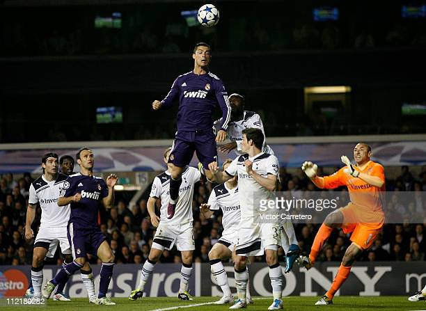 Cristiano Ronaldo of Real Madrid jumps for a high ball during the UEFA Champions League quarter final second leg match between Tottenham Hotspur and...