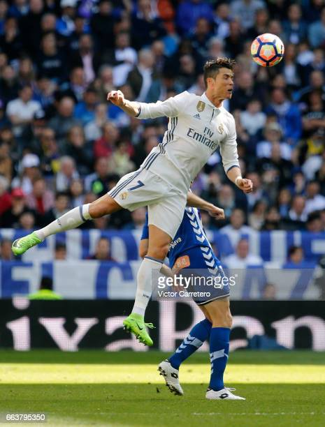 Cristiano Ronaldo of Real Madrid jumps for the ball during the La Liga match between Real Madrid and Deportivo Alaves at Estadio Santiago Bernabeu on...
