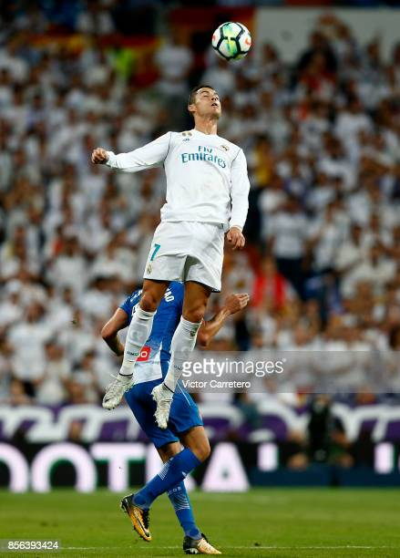 Cristiano Ronaldo of Real Madrid jumps for the ball during the La Liga match between Real Madrid and Espanyol at Estadio Santiago Bernabeu on October...