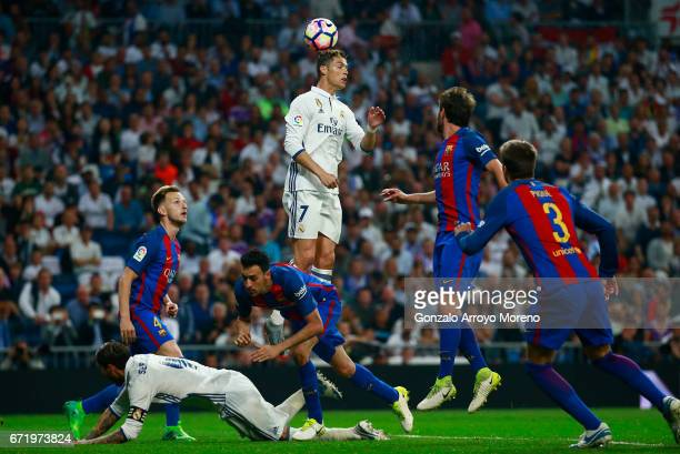 Cristiano Ronaldo of Real Madrid jumps highest to win a header during the La Liga match between Real Madrid CF and FC Barcelona at Estadio Bernabeu...