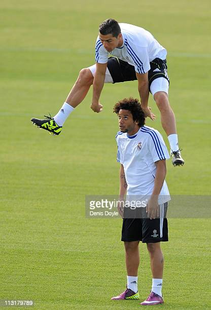 Cristiano Ronaldo of Real Madrid jumps over Marcelo during a training session at Valdebebas training ground ahead of their UEFA Champions League...