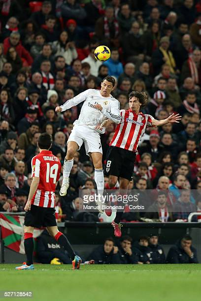 Cristiano Ronaldo of Real Madrid jumps to head the ball under pressure from Ander Iturraspe of Athletic Club Bilbao during the La Liga football match...