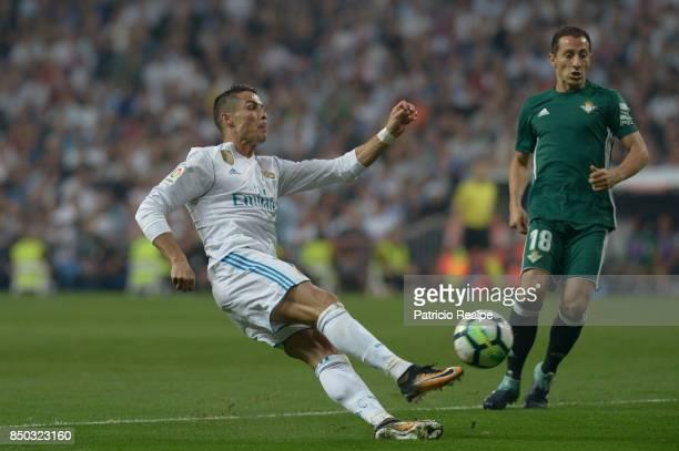 Cristiano Ronaldo of Real Madrid kicks the ball during a match between Real Madrid and Betis as part of La Liga at Santiago Bernabeu Stadium on...