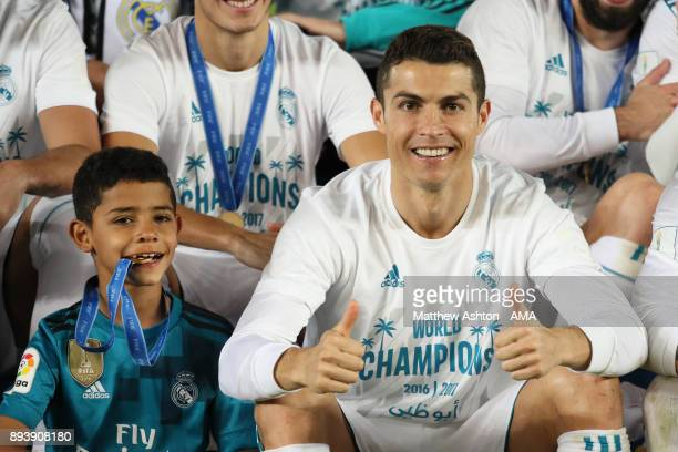 Cristiano Ronaldo of Real Madrid lifts celebrates with his son Cristiano Ronaldo Jnr and his teammates at the end of the FIFA Club World Cup UAE 2017...