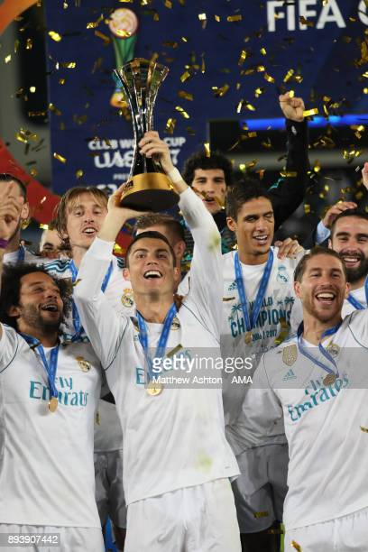 Cristiano Ronaldo of Real Madrid lifts the trophy with his teammates at the end of the FIFA Club World Cup UAE 2017 final match between Gremio and...