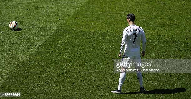 Cristiano Ronaldo of Real Madrid lines up a free kick during the La Liga match between Real Madrid CF and Granada CF at Estadio Santiago Bernabeu on...