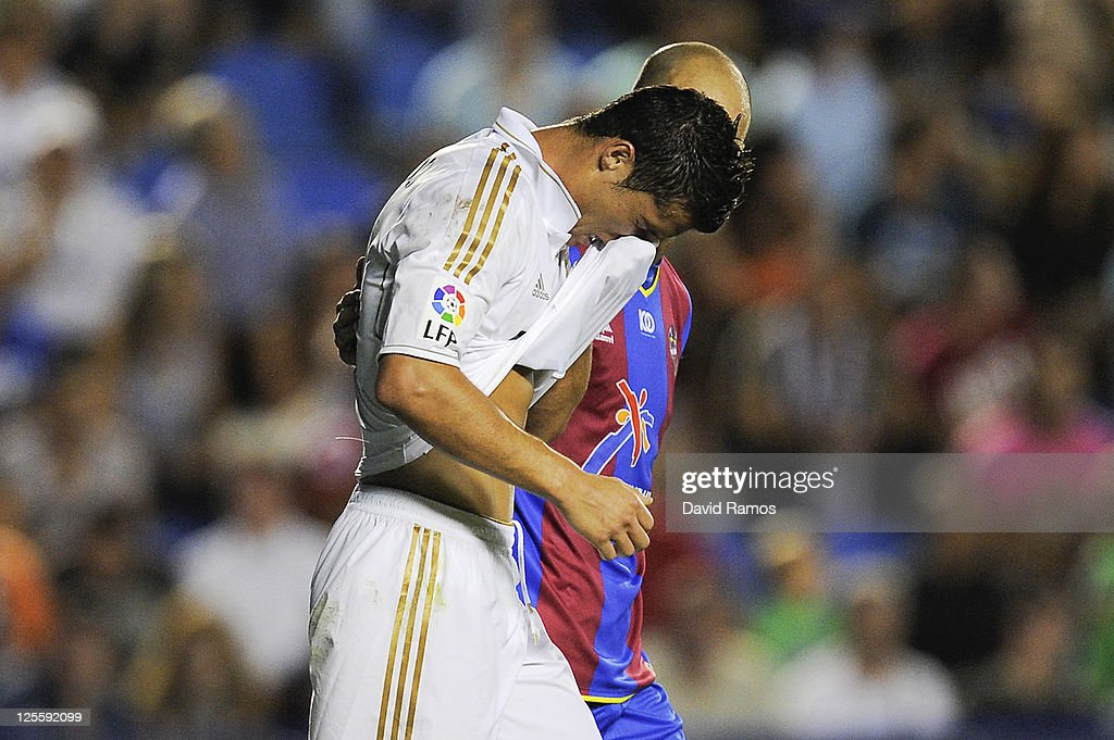 Cristiano Ronaldo of Real Madrid looks down dejected after missing a chance to score during the La Liga match between Levante UD and Real Madrid CF at Ciutat de Valencia Stadium on September 18, 2011 in Valencia, Spain. Levante UD won 1-0.