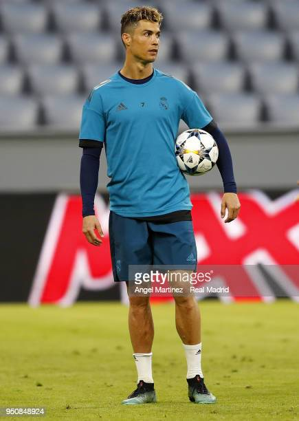 Cristiano Ronaldo of Real Madrid looks on during a training session on the eve of the UEFA Champions League semi final first leg against Bayern...