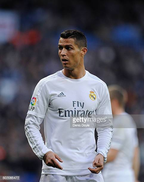 Cristiano Ronaldo of Real Madrid looks on during the La Liga match between Real Madrid and Rayo Vallecano at estadio Santiago Bernabeu on December 20...