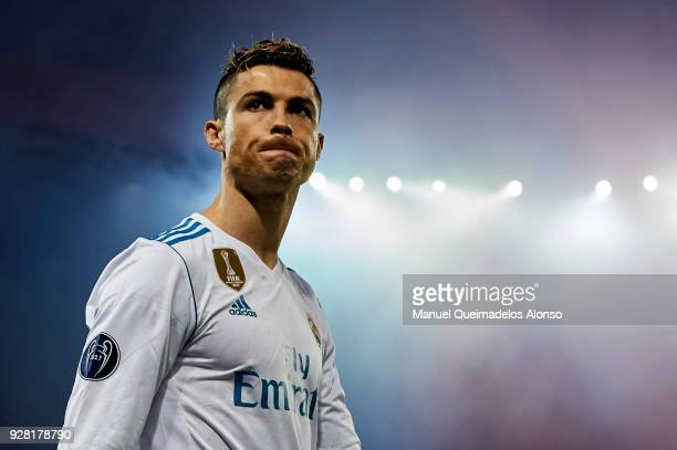 Cristiano Ronaldo of Real Madrid looks on during the UEFA Champions League Round of 16 Second Leg match between Paris SaintGermain and Real Madrid at...