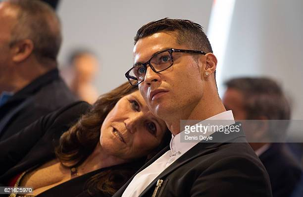 Cristiano Ronaldo of Real Madrid looks on with his mother Maria Dolores dos Santos Aveiro during his press conference after signing a new five-year...