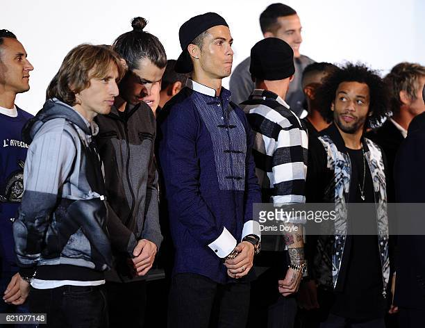 Cristiano Ronaldo of Real Madrid looks on with teammates Luka Modric Gareth Bale and Marcelo during a promotional event for the German carmaker Audi...