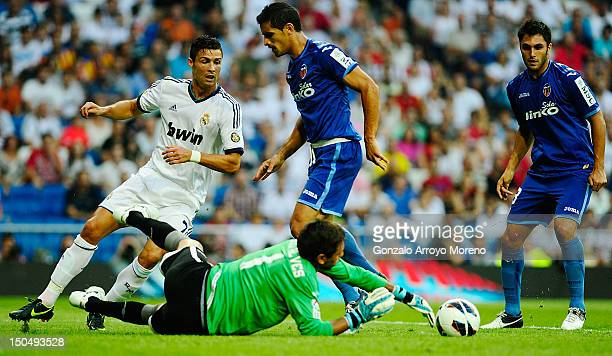 Cristiano Ronaldo of Real Madrid looks to goalkeeper Diego Alves of Valencia stopping the ball during the la Liga match between Real madrid and...