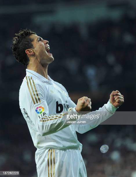 Cristiano Ronaldo of Real Madrid looks up to where is mother is seated as he celebrates scoring his sides opening goal during the Copa del Rey...
