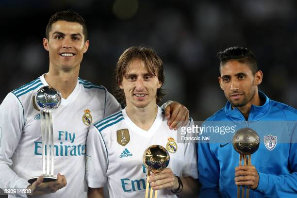 Cristiano Ronaldo of Real Madrid Luka Modric of Real Madrid and Jonathan Urretaviscaya of CF Pachuca pose with there adidas Golden Ball trophys after...