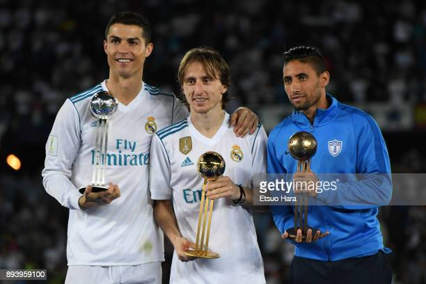 Cristiano Ronaldo of Real Madrid Luka Modric of Real Madrid and Jonathan Urretaviscaya of CF Pachuca pose with their adidas Golden Ball trophys after...