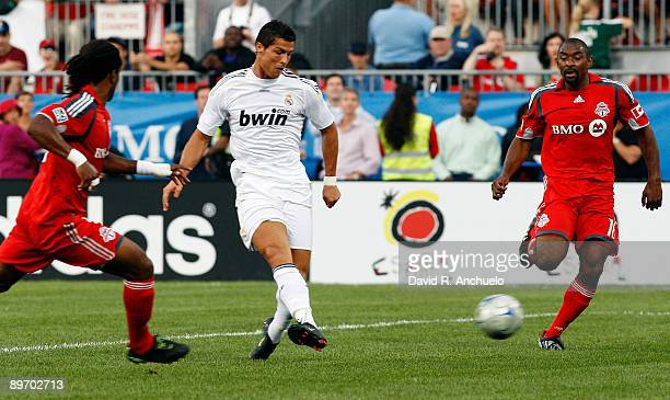 Cristiano Ronaldo of Real Madrid passes the ball during the match between Toronto FC and Real Madrid at BMO Field on August 7 2009 in Toronto Canada