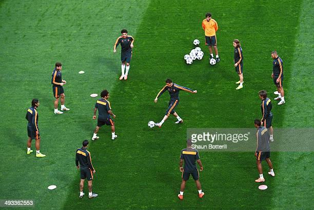 Cristiano Ronaldo of Real Madrid passes the ball to Pepe of Real Madrid during a Real Madrid training session ahead of the UEFA Champions League...