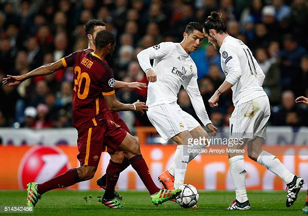 Cristiano Ronaldo of Real Madrid passes to Gareth Bale of Real Madrid as he is closed down by Seydou Keita of Roma during the UEFA Champions League...