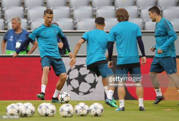 Cristiano Ronaldo of Real Madrid performs a drill with team mates during the Real Madrid training session ahead of the UEFA Champions League semi...